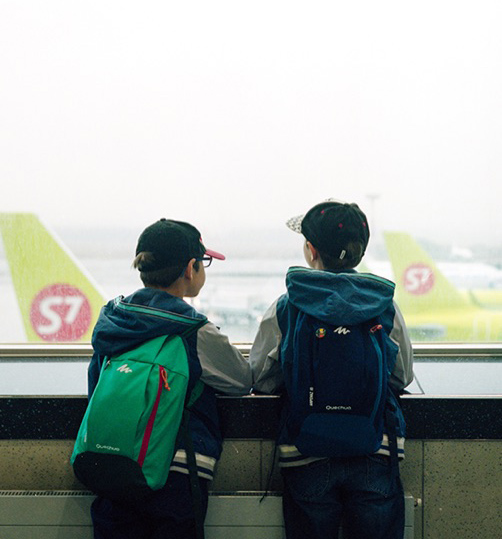 two children at an airport